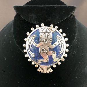 Vintage brooch with Mexican or Inca design